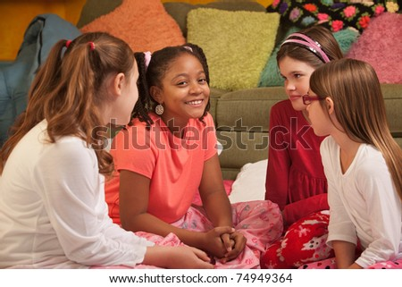 Little girls engrossed in an interesting conversation - stock photo