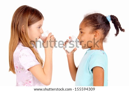 little girls holding glass of milk isolated in white - stock photo