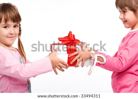 Little girls holding white gift boxes - stock photo