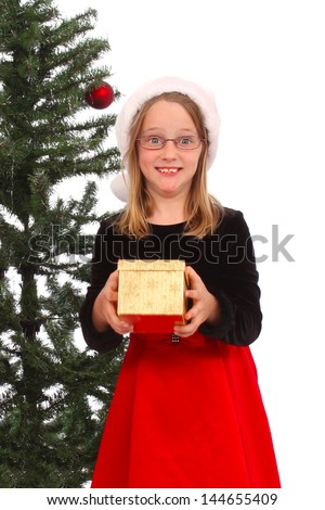 Little girls holds a present for Christmas - stock photo