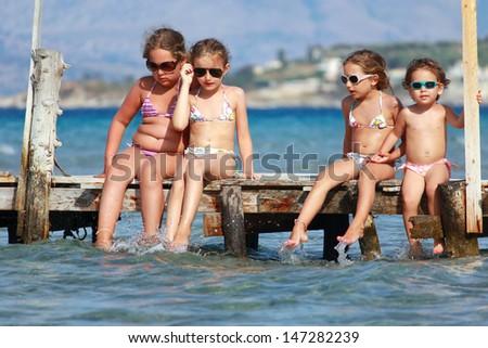 Little girls on the sea - stock photo