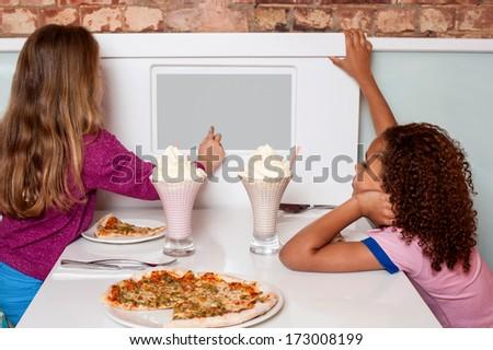 Little girls placing an order through digital menu - stock photo