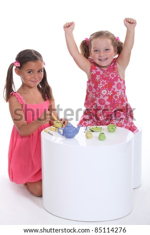 little girls playing at tea parties - stock photo
