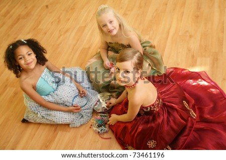 Little girls playing dress up - stock photo