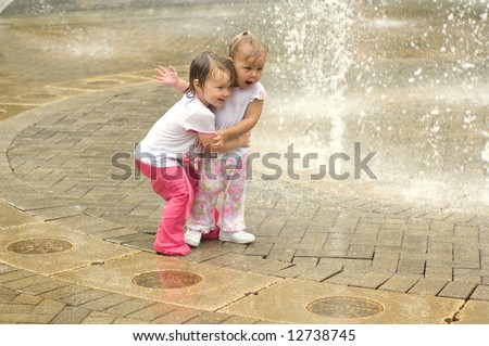 Little Girls Playing in Water - stock photo
