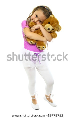 little girls posing after training with his teddy bear - stock photo