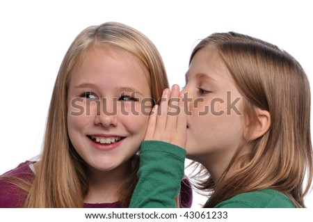 Little girls sharing a secret isolated on a white background - stock photo