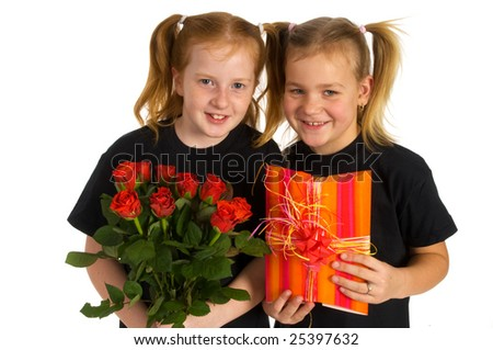 little girls with flowers and present - stock photo