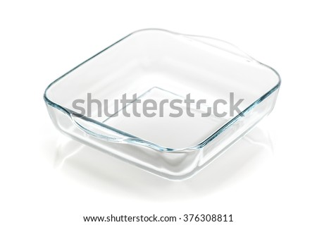 little glass saucepan isolated on white background - stock photo