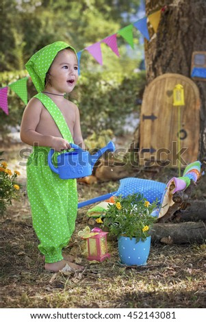 little gnome watering flowers blooming - stock photo