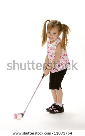 Little golf girl with pig tails holding pink golf club - stock photo