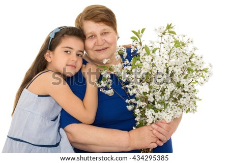 Little granddaughter tenderly embraces her old grandmother - Isolated on white background - stock photo