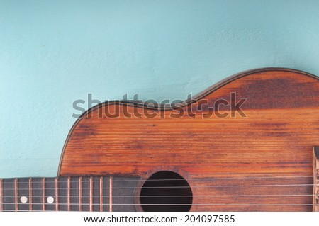Little guitar on the azure surface - stock photo