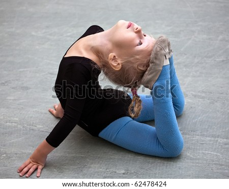 One caucasian woman exercising rhythmic gymnastics with ribbon in - Gymnastic Exercise Stock Photos Images Amp Pictures