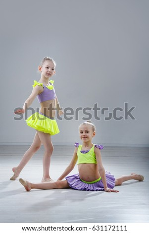 little gymnast girls in the studio gray background