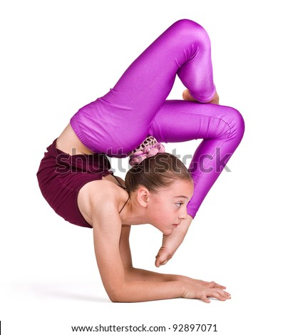 little gymnast on a white background.sporting exercise.stretch.flexibility.aerobics - stock photo