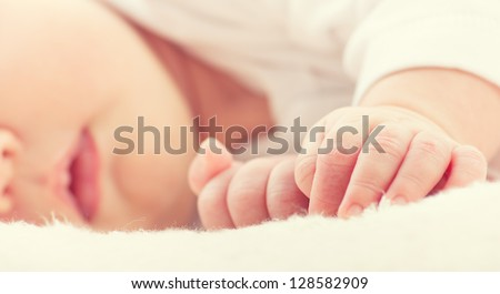 little hand of sleeping baby newborn close up - stock photo