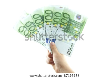 Little hand with big hundred euro bills in a row over white - stock photo