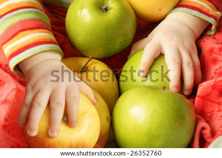 little hands hold a lot of apples - stock photo