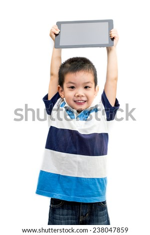 Little handsome Asian boy portrait holding tablet with smiling face isolated on white background - stock photo