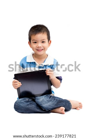 Little handsome boy portrait sitting and holding tablet with smiling face isolated on white background - stock photo