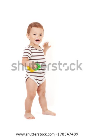 little happy baby boy with color blocks on white background - stock photo