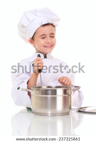 Little happy boy chef with ladle stirring in the pot isolated on white - stock photo