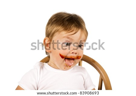 Little happy boy in white sitting in a seat. - stock photo