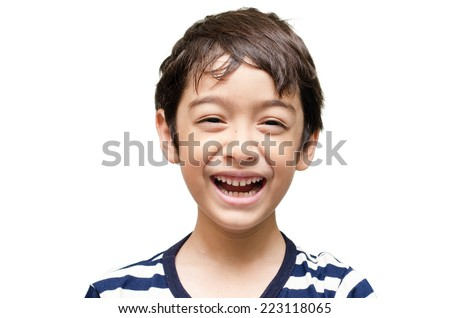 Little happy boy laugh looking at camera portrait - stock photo