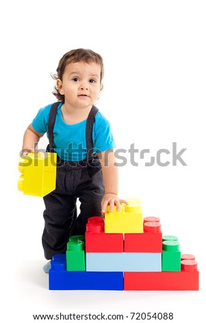 little happy boy plays with colorful cubes