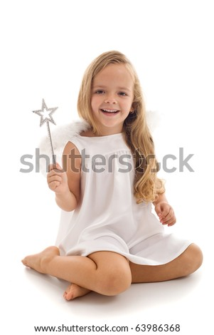 Little happy fairy or angel with magic wand sitting - isolated - stock photo