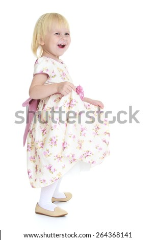 Little happy girl in a bright dress on white background - stock photo