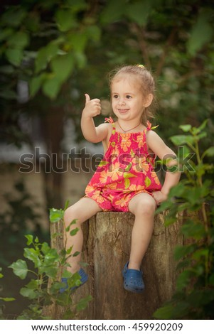 Little happy girl in red dress - stock photo