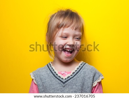 little happy girl laughing in surprise - stock photo