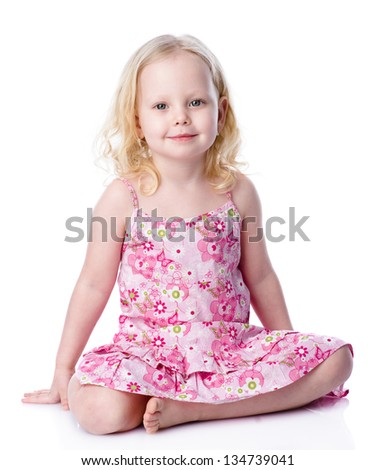 little happy girl  looking into the camera. Studio shot, isolate - stock photo