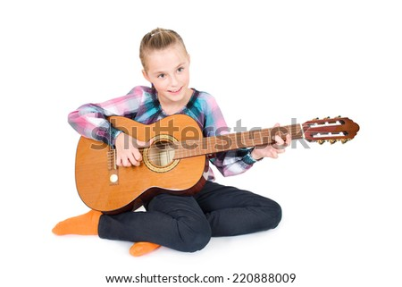 little happy girl make music with a guitar