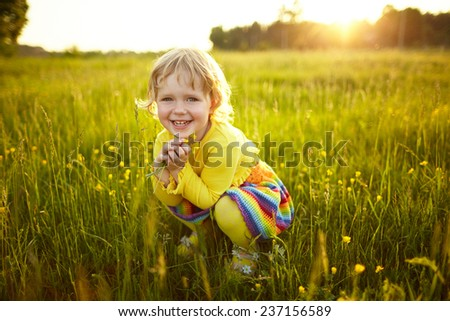 little happy girl on the meadow - stock photo