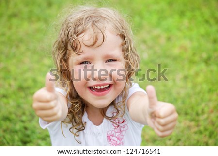 Little happy girl outdoor - stock photo