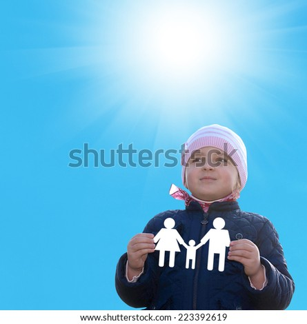 Little happy Girl with paper family on hands.Happiness Family - stock photo