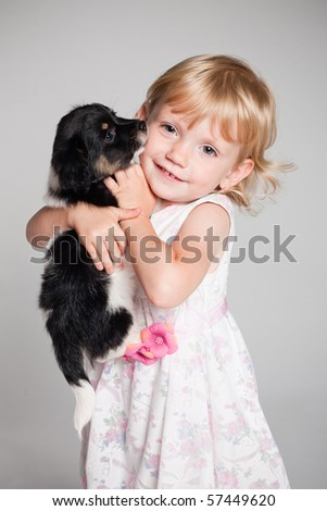 little happy girl with puppy - stock photo