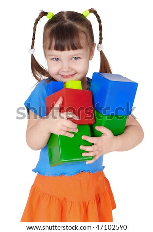 Little happy girl with toys in the hands on white