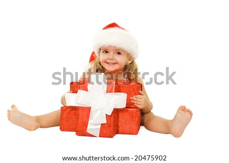 Little happy girl with xmas presents on white background - stock photo