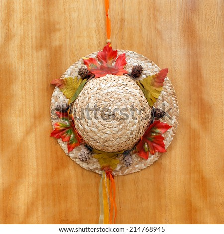 Little hat hanging on door, sweet home - stock photo