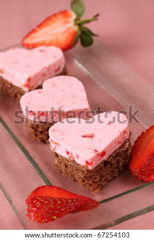 Little heart shaped cakes with strawberry mousse and fresh strawberries - stock photo