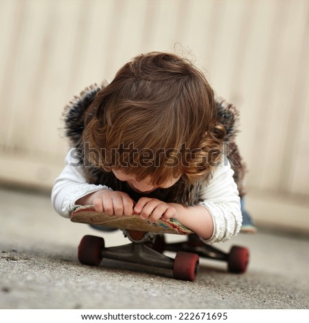 little hipster girl with skateboard portrait