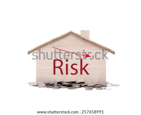 little home with the words Risk Management need to minimize liability and increase security and safety for your home - stock photo