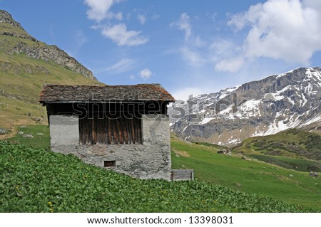 little house and panorama in the swiss alps