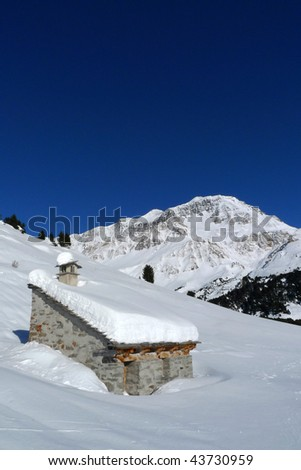 Little house in a snowy scene - stock photo