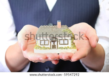 Little house in womans hands - stock photo