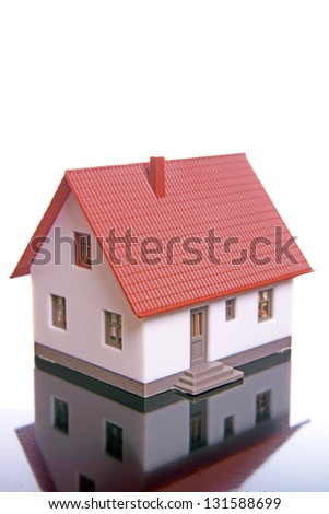 little house on a reflective background / little house